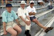From left, Jan Vaughn, Arkie Vaughn and Tom Groene, all of Lawrence, attend the Kansas University Relays. They watched the competition last Saturday at Memorial Stadium.