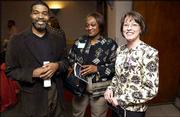 From left, Rene Brown, Vern Norwood and Christine Kenney attend the Women's Recognition Program at Kansas University. Kenney, a KU graduate and Douglas County district attorney, was named to the Women's Hall of Fame during Tuesday's program.