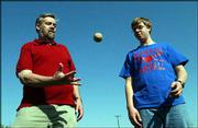 Bill James, left, and his son Isaac, 15, play catch at Hobbs Park.