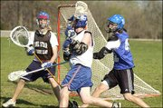 Kansas University junior Nate Macon, center, attacks the goal with