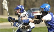 Kansas University junior Nate Macon, left, of the KU Men&#39;s Lacrosse