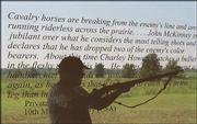 Dann Hayes demonstrates the use of a rifle on the other side of a window etched with the words of a Union soldier at the Mine Creek Battlefield State Historical Site near Pleasanton, in this file photo from 1999.