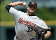 Roger Clemens delivers against Colorado. Clemens improved to 4-0 as Houston defeated the Rockies, 8-5, Saturday in Denver.