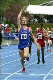 KU's Cameron Schwehr reacts after winning the 1,500-meter race. Schwehr won Saturday at the Drake Relays in Des Moines, Iowa.