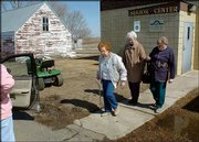From left, Gladys Wick, Mary Wick and Elsie Whitman walk from the Robinson Senior Center to a volunteer chauffeur waiting to give them a ride home. The three had just eaten lunch at the center in Robinson, N.D.