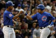 Chicago Cubs' Aramis Ramirez, right, is congratulated by Moises Alou, left, after Ramirez's two-run home run against the New York Mets. The Cubs won, 4-1, Sunday in Chicago.