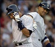 New York's derek Jeter, left, gets a pat on the back from teammate Alex Rodriguez after hitting a home run against Oakland. The Yankees defeated the Athletics, 7-5, Thursday in New York.