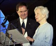 Tensie Oldfather is named the Lawrence Chamber of Commerce's Citizen of the Year in this March 2004 file photo. At left is chamber Chairman Larry McElwain. Oldfather, a noted Lawrence philanthropist, died Tuesday.
