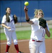 Kansas University pitcher Kassie Humphreys throws to first base for a force out against Texas. Humphreys allowed just three hits in five innings, and the Jayhawks defeated the Longhorns, 3-0, Saturday at Arrocha Ballpark. KU third baseman Nettie Fierros is at left.