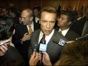 California Gov. Arnold Schwarzenegger talks to members of the media and mingles at a reception. Schwarzenegger spoke to business leaders Saturday at the Tel Aviv Hilton in Israel.