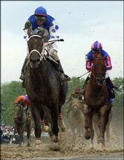 Smarty Jones with jockey Stewart Elliott up drives down the stretch to win the Kentucky Derby. Lion Heart, right, with Mike Smith up, finished second Saturday at Churchill Downs in Louisville, Ky.