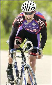 Adrian O'Hara of Overland Park grimaces as he pedals toward the finish of the prologue time trial at the inaugural VeloTek Grand Prix. Cyclists raced against the clock in the 2.5K time trial prologue Saturday at Clinton State Park. The VeloTek road race is today at Perry Lake.