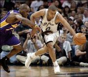 L.A. Lakers guard Gary Payton, left, and San Antonio guard Tony Parker chase a loose ball. The Spurs beat the Lakers, 95-85, Wednesday in San Antonio.