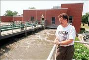Mayor Mike Rundle is shown in an August 2000 file photo at the water treatment plant.