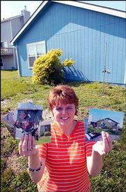 Lori Crabtree, who teaches elementary school in McLouth and lives in southwest Lawrence, is finally seeing her life get back to normal. A year ago today, a tornado struck southwest Lawrence and caused nearly $5 million in damage, including to Crabtree's house in the 4700 block of West 25th Street. She's displaying pictures that show where the tornado tore a shed away from her house, leaving only a gravel foundation that still marks the spot today.