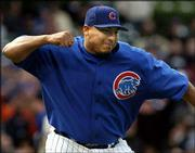 Chicago pitcher Carlos Zambrano celebrates after recording the final out against Colorado. Zambrano pitched a two-hitter in the Cubs' 11-0 victory Friday in Chicago.