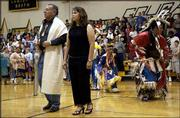 South Junior High principal Russell Blackbird and Rene Carey Cummings perform a tribal dance at the beginning of a ceremony honoring the return of Cummings, a veteran of the war in Iraq and a former South Junior High student. Friday's assembly at the school also featured the presentation of American Indian gifts.