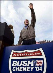 President Bush arrives at a campaign rally at Copeland Park Baseball Field in La Crosse, Wisc. The President was on a one-day campaign swing Friday through Iowa and Wisconsin.
