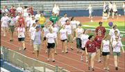Participants in the Relay for Life walk around the track at Memorial Stadium. The fund raiser for the American Cancer Society, which began at 6 p.m. Friday and was to continue until 6 a.m. today, included music, contests and other activities.
