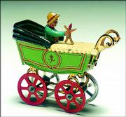 This baby carriage is a penny toy only 3 1/2 inches long. It was auctioned for $578 by Theriault's of Annapolis, Md.