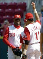 Cincinnati's Ken Griffey Jr., left, congratulates teammate Barry Larkin after the Reds' victory over San Francisco. Griffey homered twice, and Larkin homered once as the Reds defeated the Giants, 5-3, Saturday in Cincinnati.