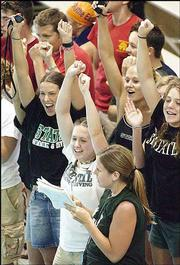 The Free State High cheering section celebrates a close win by the Firebirds in the finals of the 200-yard freestyle relay. The Firebirds placed third at the Sunflower League meet Saturday at the Lawrence Indoor Aquatic Center. Lawrence High finished in fourth place. More photos from Saturday's action can be found on page 12C.