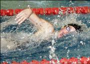 Free State's Katie Swank swims the 100-yard freestyle finals. Swank won the event, posting a time of 54.73.