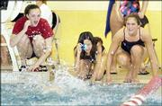 LHS swimmers Kristen Longanecker, Melissa Farve and Kristi Rudman cheer for teammate Julia Szabo during the 100-yard butterfly finals.