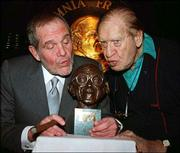 Comedians Alan King, left, and Henny Youngman pretend to smooch a bust of George Burns at the Friars Club in New York in this file photo of Jan. 16, 1992. King, who built a long comedy career in nightclubs and television that he later expanded to character acting on the silver screen, died Sunday in New York. He was 76.