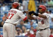 Anaheim's Vladimir Guerrero, left, congratulates Jose Guillen after Guillen hit a two-run homer against New York. The Angels defeated the Yankees, 11-2, Wednesday in New York.