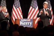 Sen. John Kerry, right, addresses presidential campaign supporters as General Wesley Clark, left, listens in Little Rock, Ark. Kerry told Associated Press Radio that he thought President Bush's handling of Iraq had been a failure.