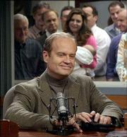 """Kelsey Grammer as Dr. Frasier Crane pauses a moment after the director calls """"cut"""" after Crane read his final broadcast message in the show&squot;s radio station set. The last episode was filmed in March."""
