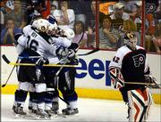 Tampa Bay Lightning players celebrate a goal by Brad Richards in the third period as Philadelphia goalie Robert Esche skates away. The Lightning won Game 3 of the Eastern Conference finals, 4-1, Thursday in Philadelphia to take a 2-1 lead in the series.