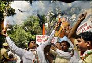 Congress Party supporters celebrate in New Delhi, India. The opposition Congress Party and its allies claimed victory Thursday in Indian elections and declared its leader, Sonia Gandhi, would be the next prime minister.