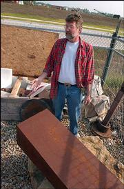 Lawrence arts commissioner Jeff Ridgway looks over abandoned and donated artworks from past Outdoor Downtown Sculpture Exhibitions. Ridgway recently found a sculpture broken, prompting him to demand the city find more suitable storage for the pieces.