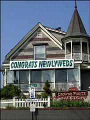 A congratulatory sign for newlyweds appears displayed on the front of the Crowne Pointe Inn, in Provincetown, Mass., the weekend before gay marriage is to become legal in the state. Provincetown, long considered a destination for gay couples to vacation and relax, is expected to become a location where they may marry as well.