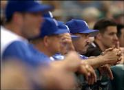 Kansas City manager Tony Pena, second from right, watches from the dugout as his team struggles Wednesday against Toronto at Kauffman Stadium. The Royals, who finished 83-79 last season after losing 100 games in 2002, haven't been able to maintain that improvement this season. After Saturday's game against Oakland, the Royals were 11-23 and 101/2 games back in the AL Central.