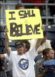 A Royals fan holds a sign of support at a game against Toronto on Wednesday at Kauffman Stadium.