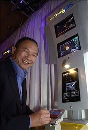 "Filmmaker John Woo plays ""Metroid: Prime Hunters"" on Nintendo's Game Boy DS, the new dual screen hand-held system, at the Electronic Entertainment Expo in Los Angeles. Nintendo and Woo are exploring opportunities for a Metroid motion picture."
