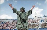 "Free State graduate Jacob Smith raises his arms and shouts ""I love you, Mom"" while walking to pick up his diploma. Free State High School&squot;s Class of 2004 graduated Sunday at Kansas University&squot;s Memorial Stadium."