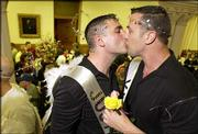 David Rudeurick, 34, left, and Michael Hight, 39, both of Somerville, Mass., kiss inside City Hall in Cambridge, Mass. The couple, who have been together for four years, were among the same-sex couples who gathered Sunday to wait for marriage licenses to be issued at midnight. They will marry today.