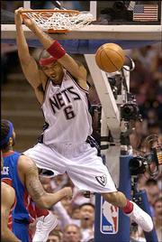New Jersey's Kenyon Martin slams early in the Nets' 81-75 loss to Detroit. The outcome Sunday in East Rutherford, N.J., forced a Game 7 in the teams' second-round NBA playoff series.