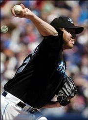 Toronto's Roy Halladay pitches to a Boston batter in the sixth inning of the Blue Jays' 3-1 victory. Halladay outpitched Pedro Martinez on Sunday in Toronto.