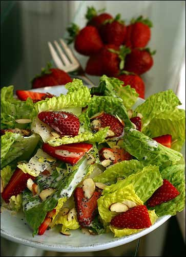 Strawberry Salad With Poppy Seed Dressing is a simple combination of romaine lettuce, strawberry slices and almond slivers.