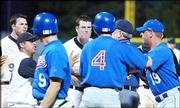 Kansas State's Jim Ripley, center, confronts Kansas University players near home plate during a bench-clearing brawl. Tempers flared during the sixth inning, during which the Jayhawks scored 16 runs Saturday in Manhattan. KU won, 19-6.