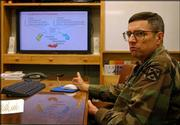 Col. Larry Saul gives a presentation about the Center for Army Lessons Learned, in his office at Fort Leavenworth. The center focuses on adapting to enemy tactics in Iraq and Afghanistan.