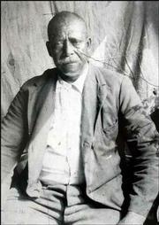 John Watkins, above, is buried in an unmarked cemetery in Weir. He died in 1924.