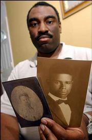 Ron Curtis holds photographs of his great-great-grandmother, Amanda Watkins, left, and his distant cousin Willie Watkins. Efforts are under way to preserve the cemetery in Weir, where many of Curtis' ancestors are buried.