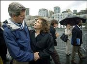 Democratic presidential candidate Sen. John Kerry, D-Mass., is greeted by his wife, Teresa Heinz Kerry, after speaking about his energy policy at a rally in Seattle. John Kerry announced Wednesday he would accept the Democratic nomination for president at the summer convention, although it would likely leave him at a fund-raising disadvantage.