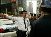 A New York City Police captain, left, deploys police officers in front of a hotel in Times Square as part of a counterterrorism deployment initiative that is meant as a show of police force on city streets in the upcoming busy tourist season. Atty. Gen. John Ashcroft issued a warning Wednesday of imminent terror threats to the United States.
